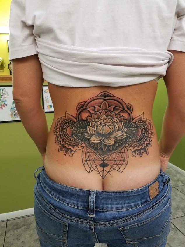 Lower back mandala tattoo