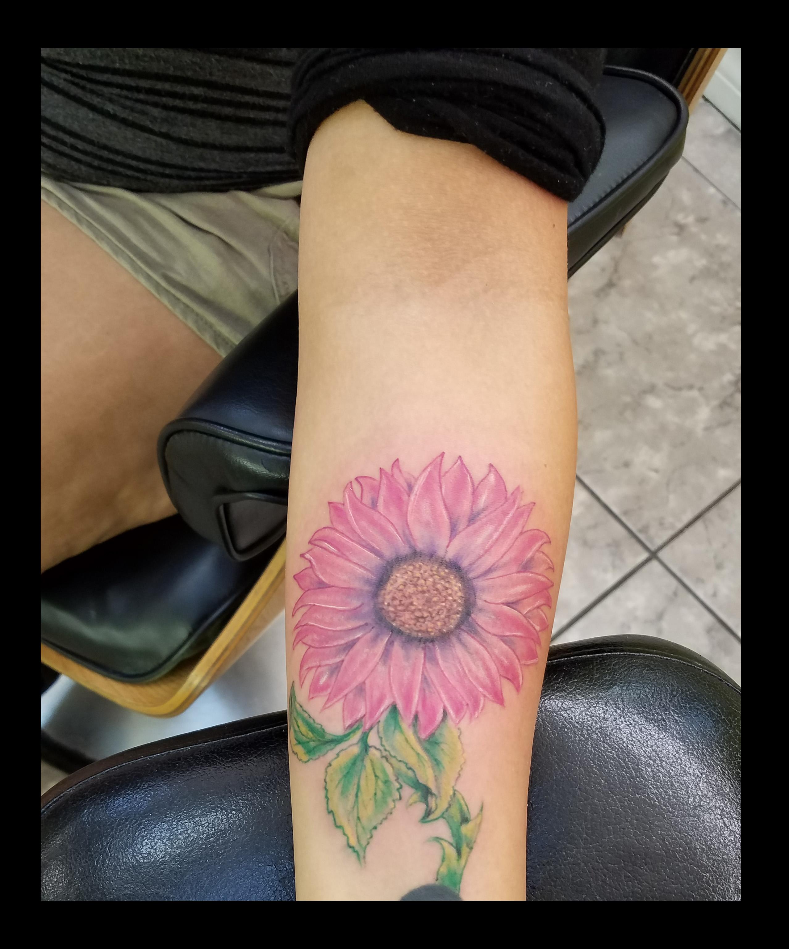 Sunflower tattoo by Ruben